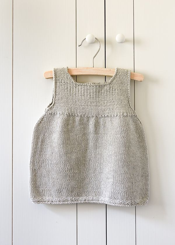 259f85e3a1b2 Clean + Simple Baby Dress Few things prompt knitters into action ...