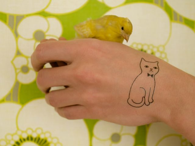 {kitty temp. tattoo + little yellow bird} Tattyoo - so cute!