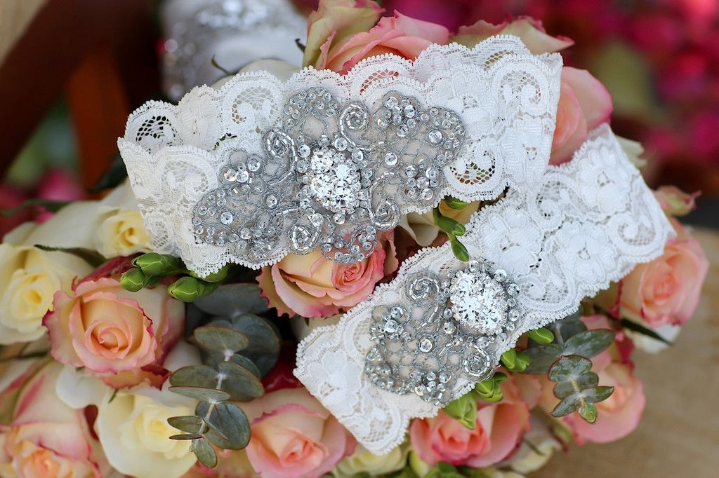 Vintage Crystal    Hand selected crystal bridal buttons and brooches adorned on vintage inspired hand beaded trimmings layered onFrench imported lace. Comes with matching toss as shown in the photo gallery.    *Photo gallery shows examples of the Blue and Champagne trim option.    Photo Credits   Stacy Able Photography