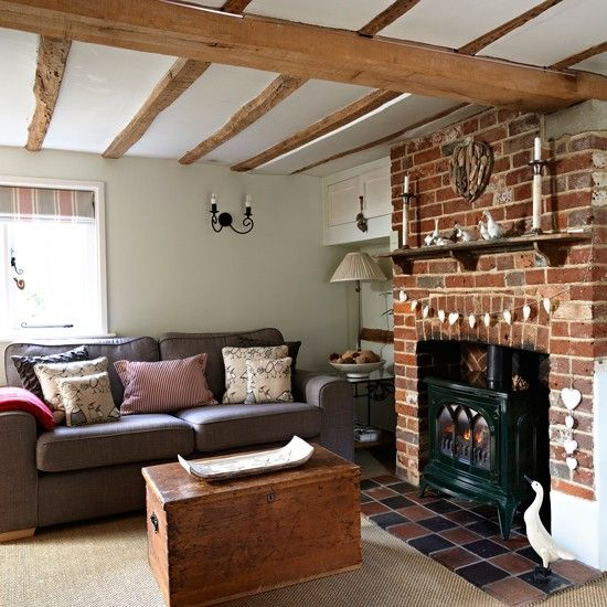 stunning country living room fireplace ideas   Country living room with wooden beams and exposed brick ...
