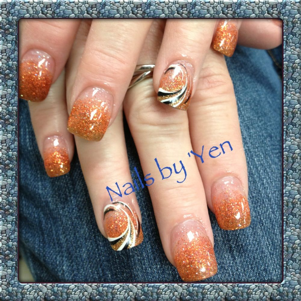 Golden orange and brown fade ombre with nail design. Great