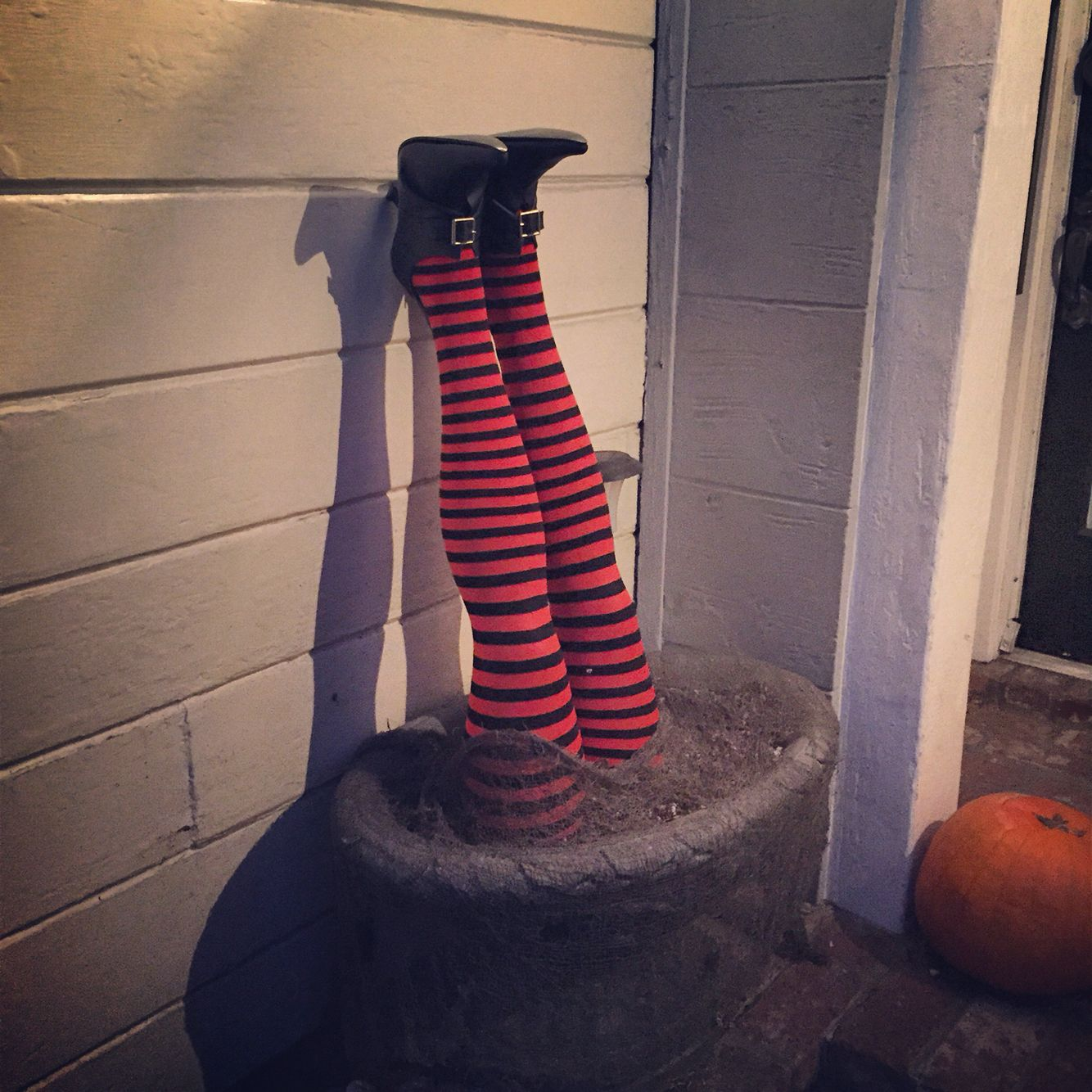 Mannequin legs, striped Halloween leggings, witches shoes for a DIY - front yard halloween decorations