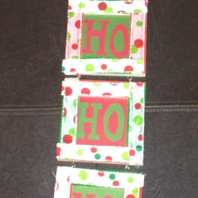 DIY- holiday decoration. Photo frames, paint, paper and ribbon.