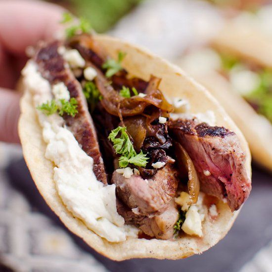 Steak & Whipped Bleu Cheese Tacos are filled with tender steak and caramelized onions on top of whipped bleu cheese.