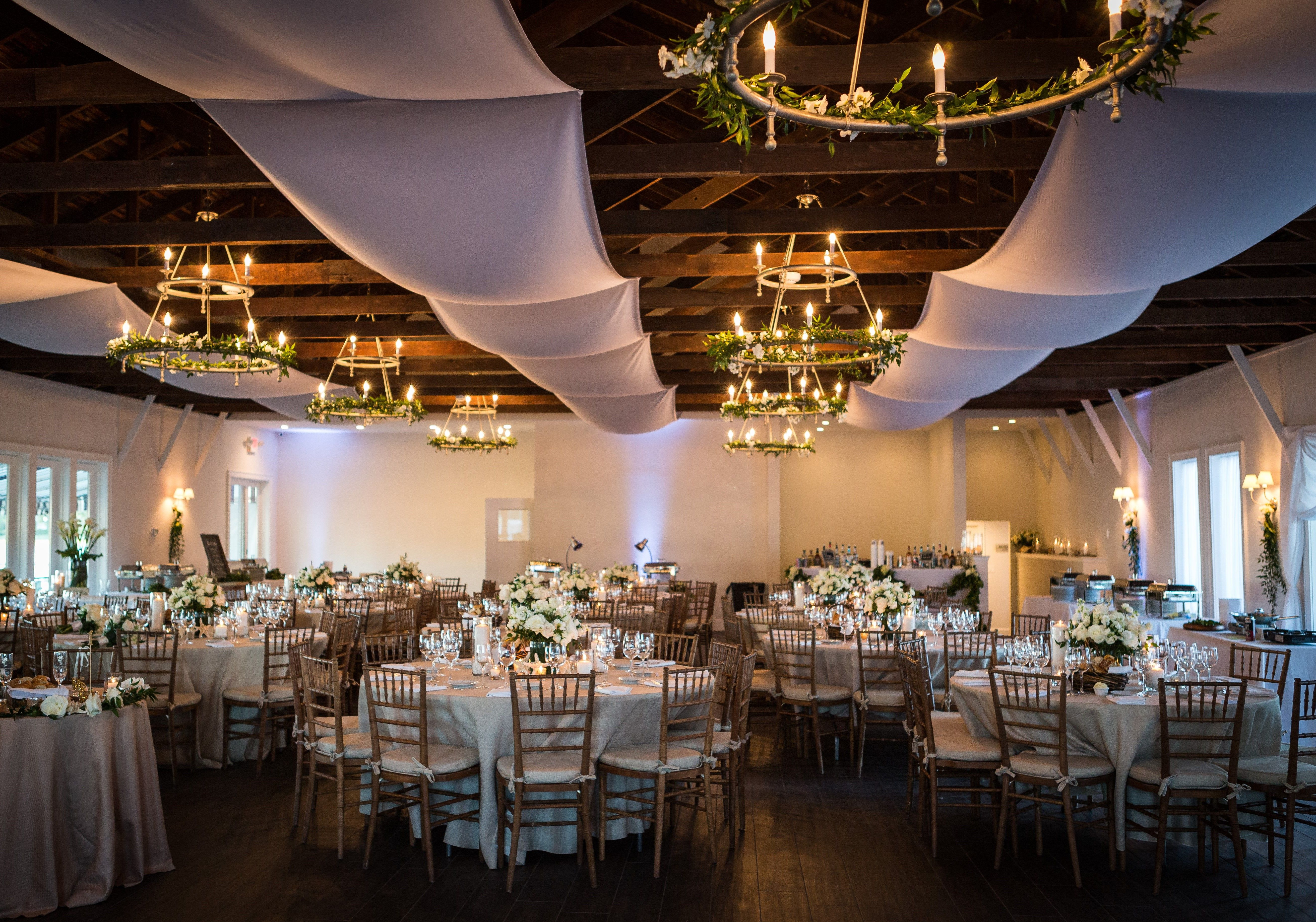 Wedding hall decoration images  The wedding venue of your dreams White cloth draping with ivy on
