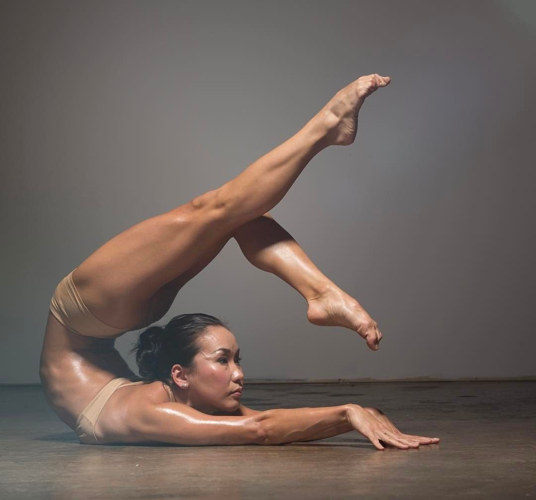Skinny contortionist naked stretching 4