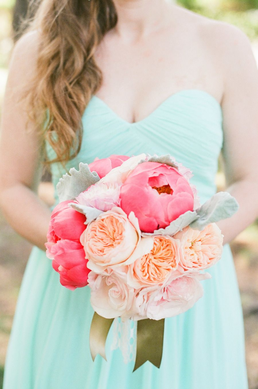 Pink and peach wedding flowers with Donna Morgan Laura dress in ...