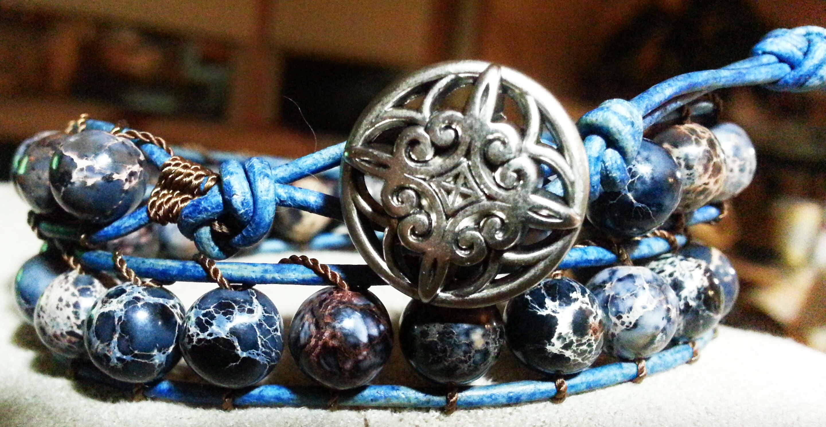 Dyed Dream Jasper with antiqued blue leather and Celtic metal shank button - sold