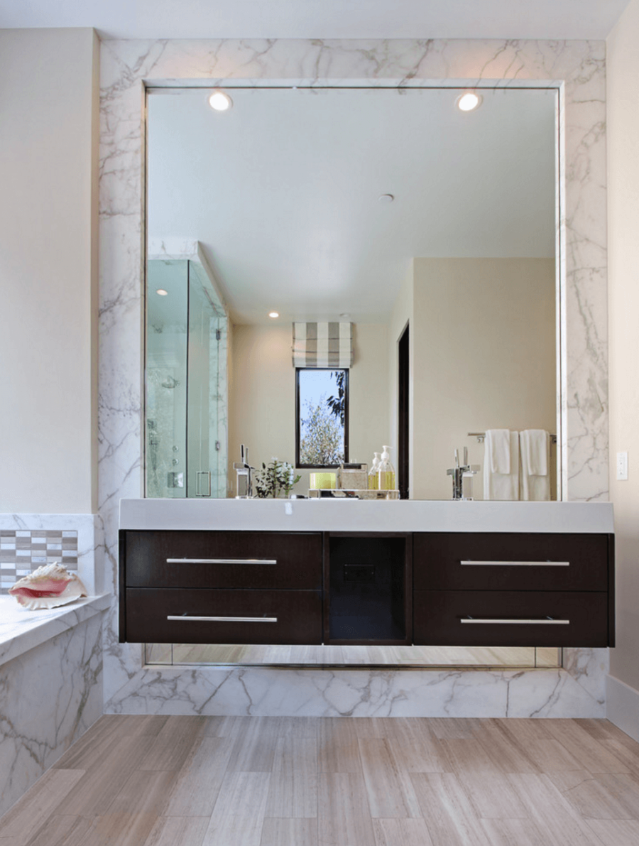 Transform Your Ordinary Bathroom With This Big Mirror Trend Small Bathroom Mirrors Minimalist Bathroom Mirrors Amazing Bathrooms