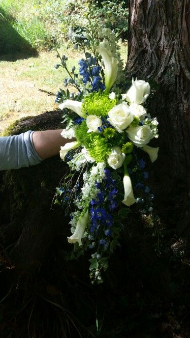 Seahawks themed wedding bouquet.