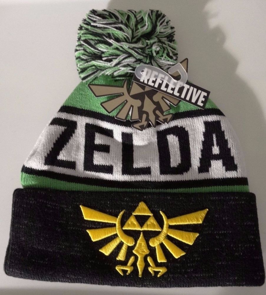 Nintendo · The Legend of Zelda Triforce Logo Nintendo Reflective Cuff Knit  Pom Hat Nwt ... d2b96c6c7f72