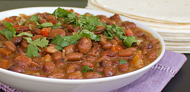 Mexican Pinto Beans without bacon. Using coriander, cumin and brown sugar and canned beans