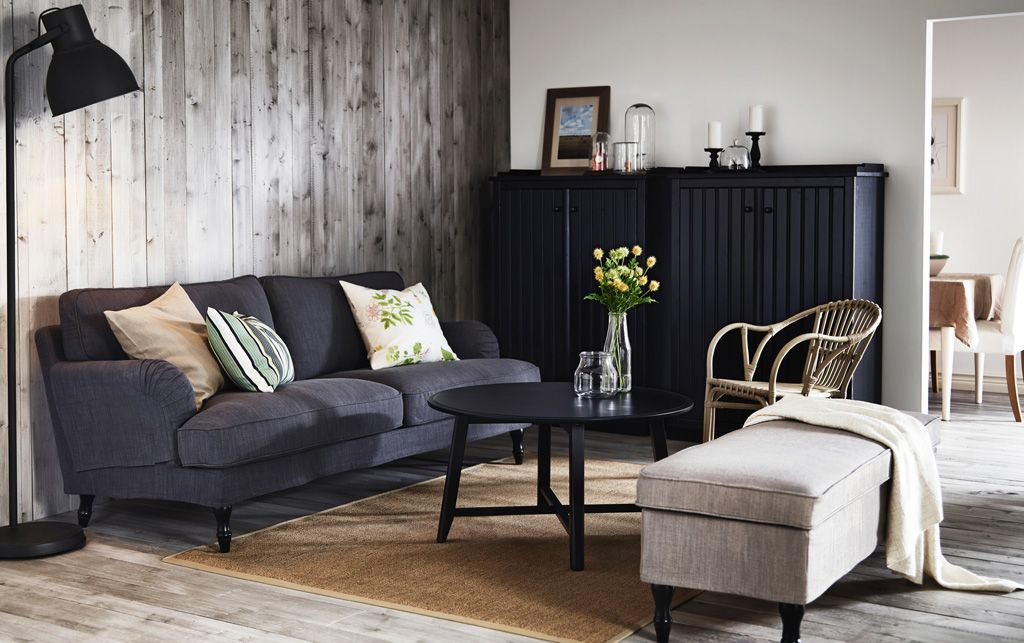 A Living Room With A Grey STOCKSUND Sofa, ARKELSTORP Storage In Black And A  KRAGSTA