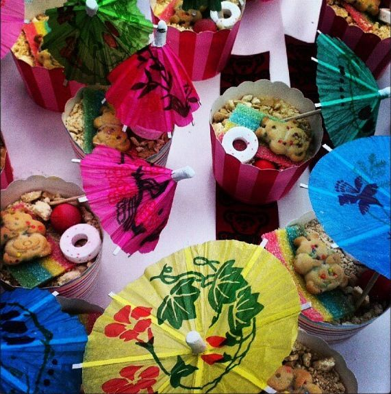 Teddy's on the beach! Made by grade 4!  Ingredients- crushed biscuits, tiny teddy, cupcake paper, umbrella, sour strap (lolly)