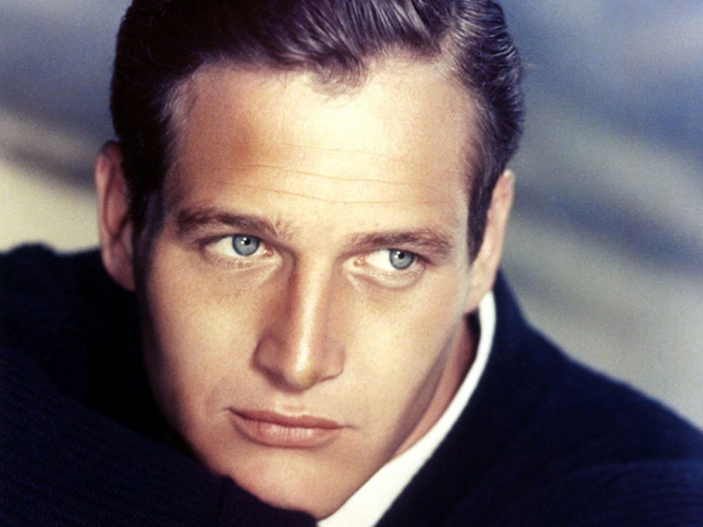 """With his striking good looks and mesmerizing blue eyes, Paul Newman was a classic Hollywood sex symbol who captured hearts in movies such as """"Cool Hand Luke,"""" """"The Hustler,"""" and """"Butch Cassidy and The Sundance Kid."""" Off-screen, he was an accomplished race car driver, philanthropist, and a loyal husband of 50 years to actress Joanne Woodward."""