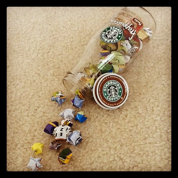 "Quirky crafts! :) I made the stars out of paper strips I cut out from old magazines, and I happened to have a Starbucks frappuccino bottle on hand, thus my creation, ""Bursting with Stars"" was born."