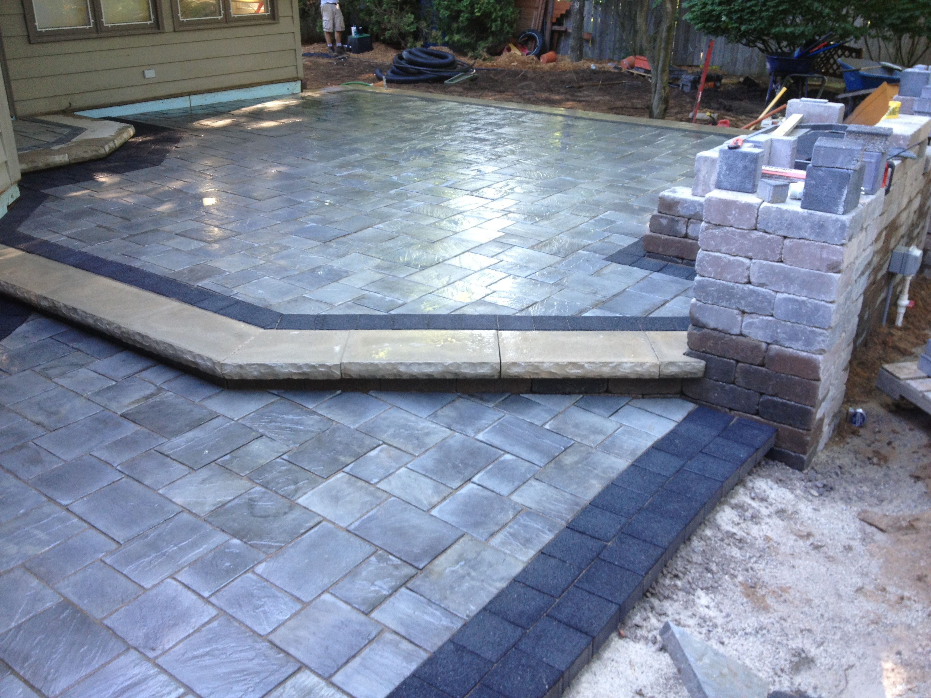 Beautiful Patio Using Unilock Brick Pavers. Stonehenge Coping, Series 3000  Black Accent Brick,