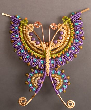 Love the mix of colourful micro-macramé and wirework. By Joan Babcock, whose book on the subject I'm thinking of buying.