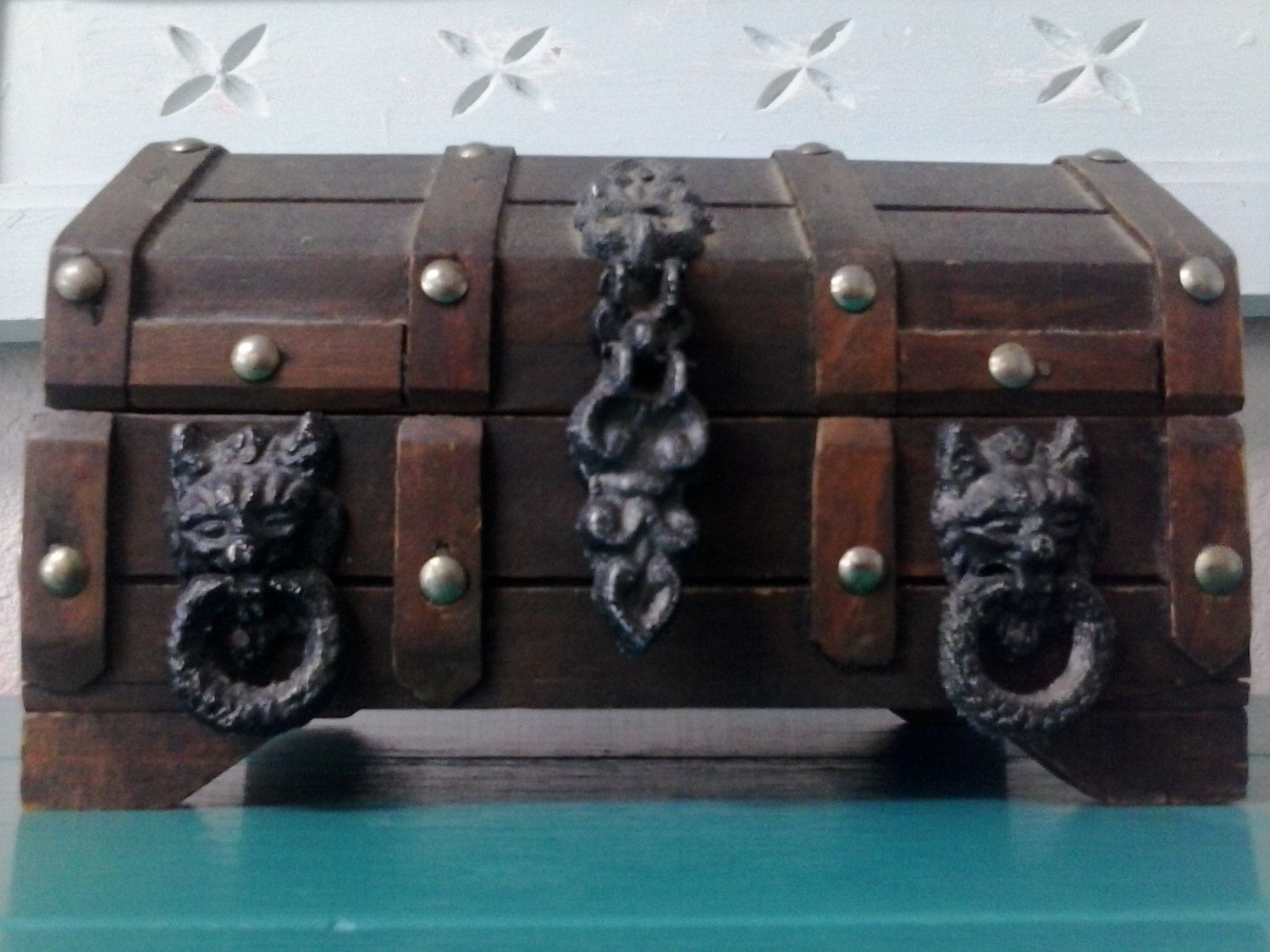 Vintage Pirates Treasure Chest Wood Trinket Jewelry Box Lion Heads Gothic Latches. $99.00, via Etsy.
