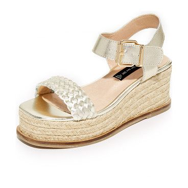 c7bfd73c6e07 sabble flatform sandals by Steven. Bands of smooth and woven metallic  leather compose these Steven