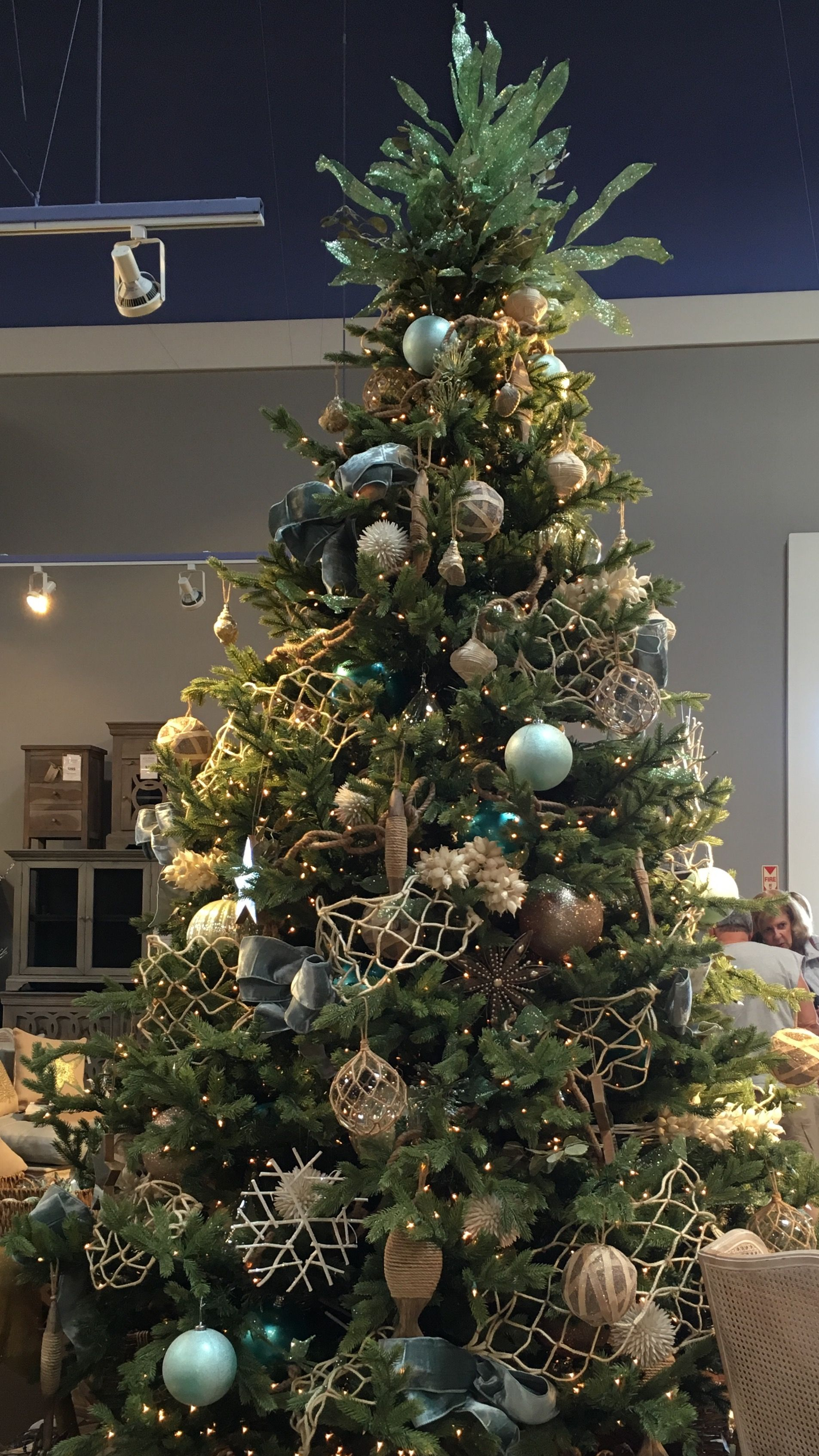 Beautifully decorated ocean themed Christmas tree in the colors of ...