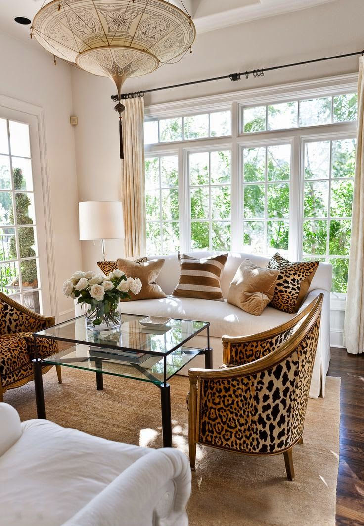 living room sitting room chandelier leopard chairs pillows white