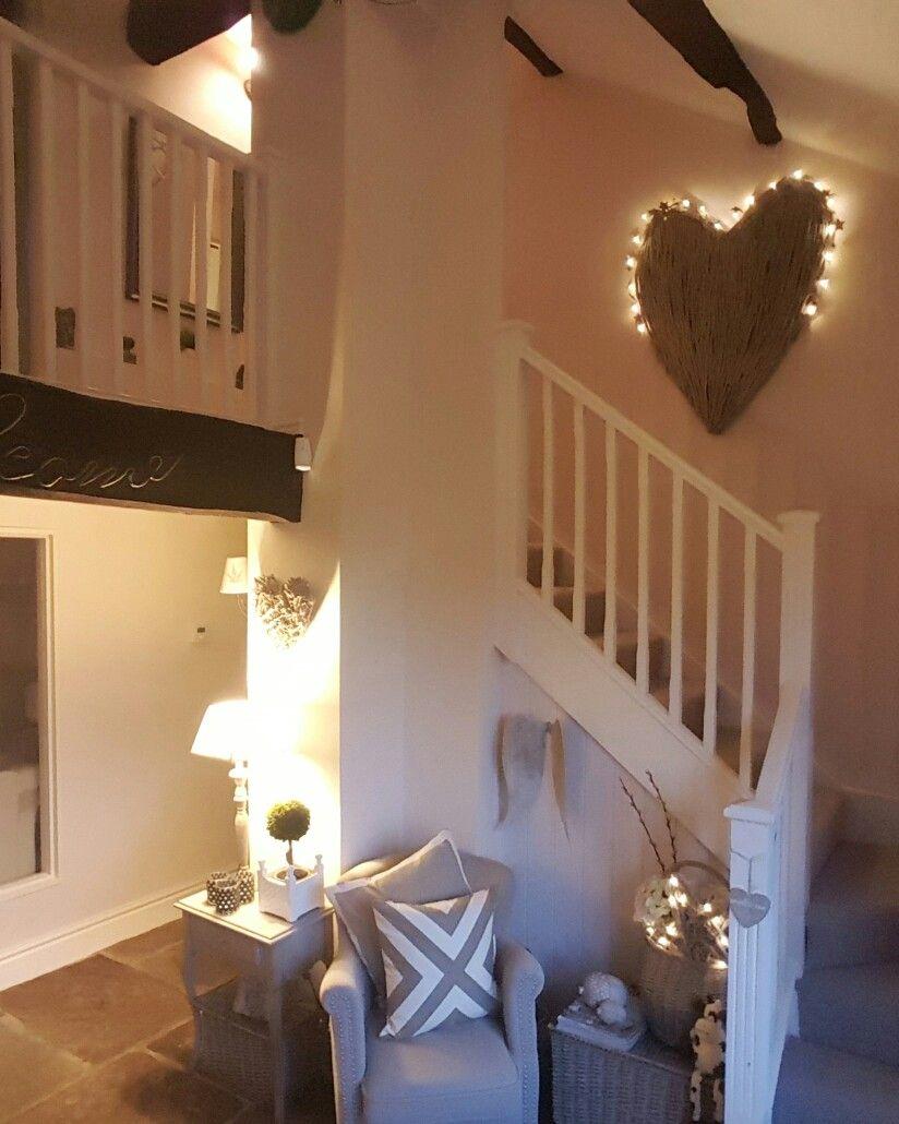 Hallway...stone floor...comfy chair...wicker heart...