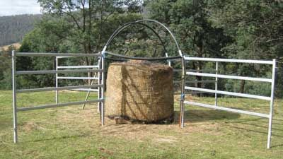 Using a round bale net feeder is a useful tool to help ...