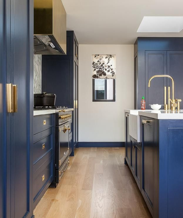 Exquisite Blue Contemporary Kitchen Features A Stunning Center Island Donning Brass Hardware And White CabinetsKitchen