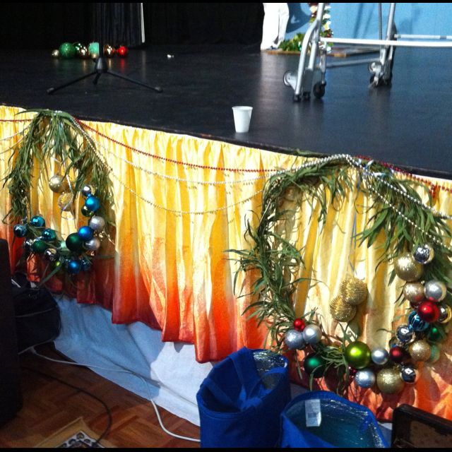 Christmas bauble wreath decorate base of stage