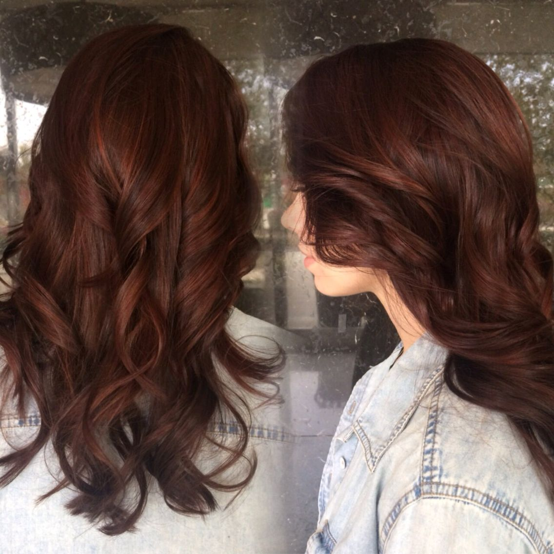 Auburn brunette with subtle red highlights peaking through