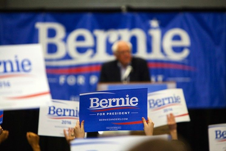 """Supporters hold up """"Bernie Sanders for President"""" signs during a rally of over 10,000 people in Madison, Wisconsin."""