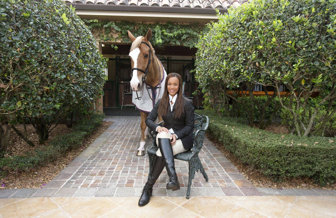 Age: 26. Riding Since: 1992. Primary Horse: Chiron S, a 14-year-old Holsteiner. Stables: Salamander Farm, Wellington, FL (20 stalls, 10 acres), and the Plains, VA (30 stalls, 200 acres). Parents: Her mother, Sheila, co-founded Black Entertainment Television with her husband, Robert L. Johnson, and is CEO of Salamander Hospitality; the divorced couple's combined worth is close to a billion dollars.   - TownandCountryMag.com