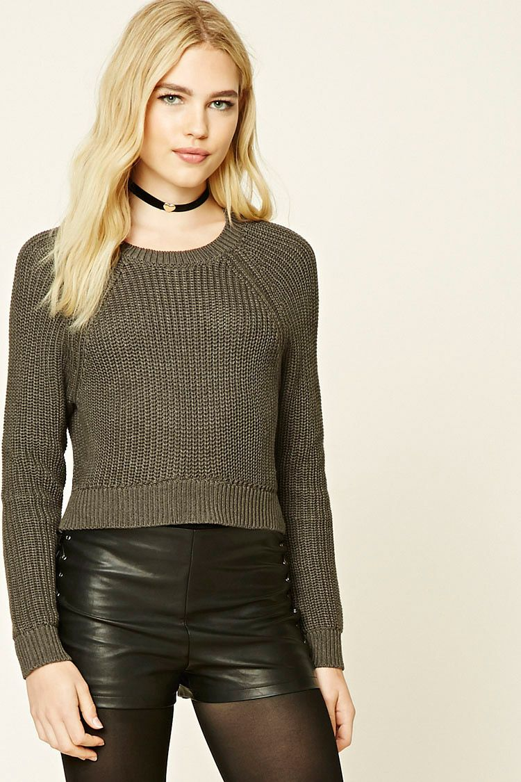 A knit sweater featuring a slightly cropped silhouette, a crew ...