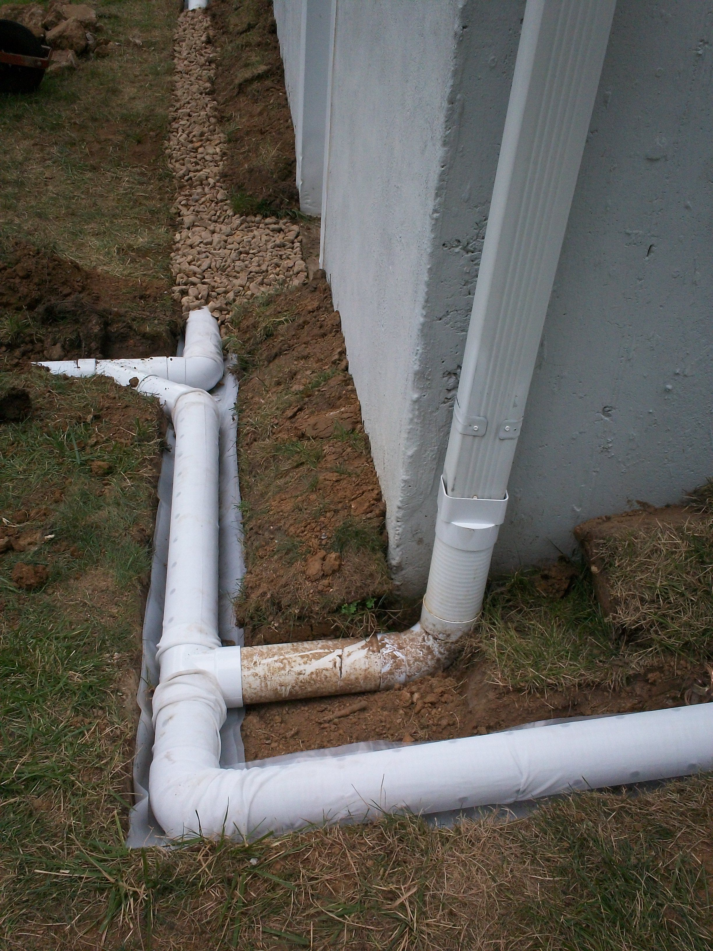 Installation in progress downspout extension connected to for Outside drainage system