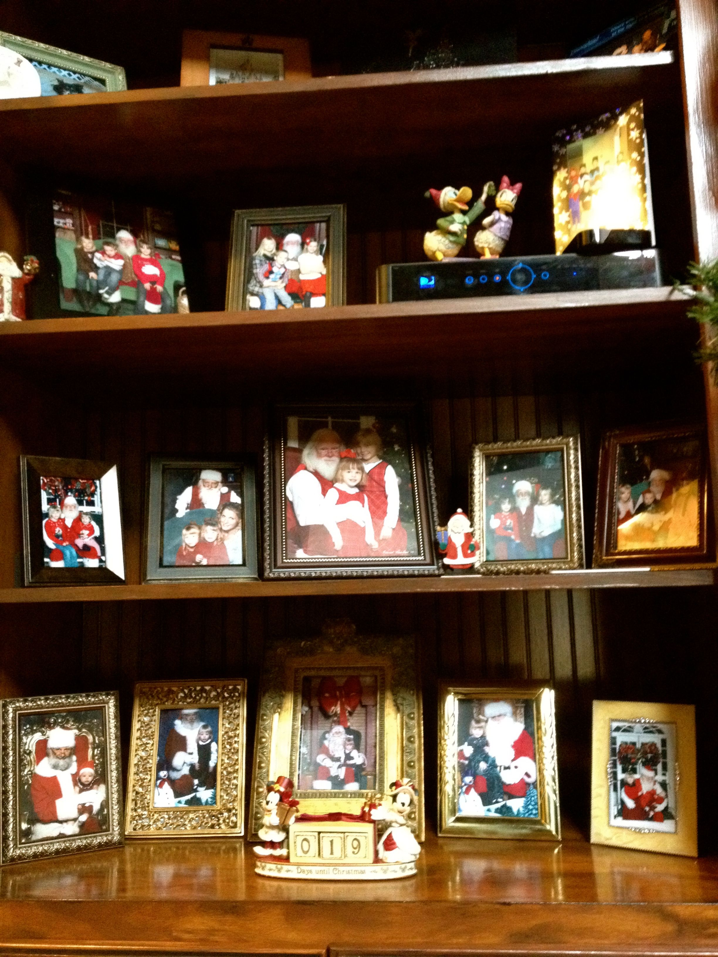 a cute way to display the kids santa pictures over the ...