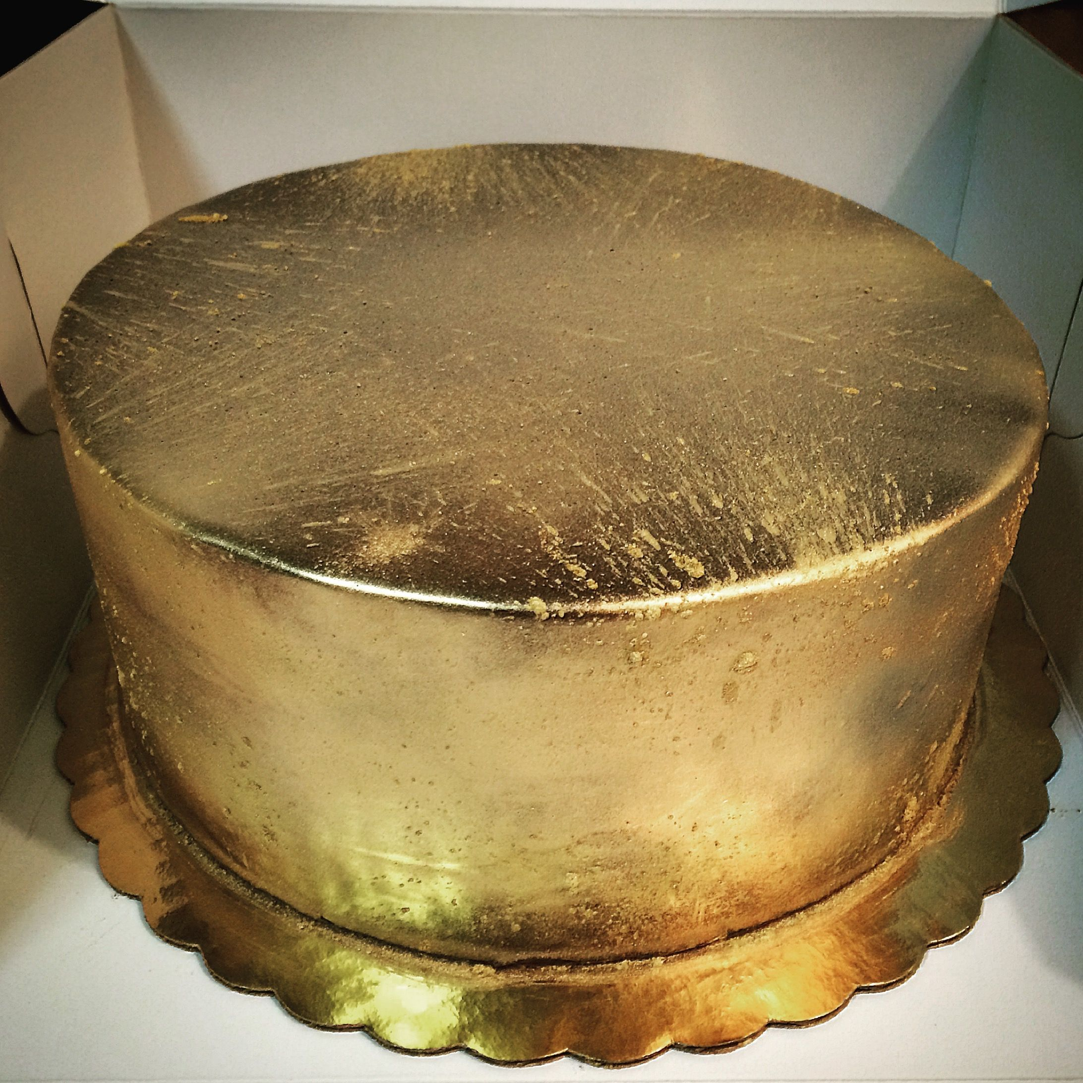 "Gold Cake with ""fireworks""."