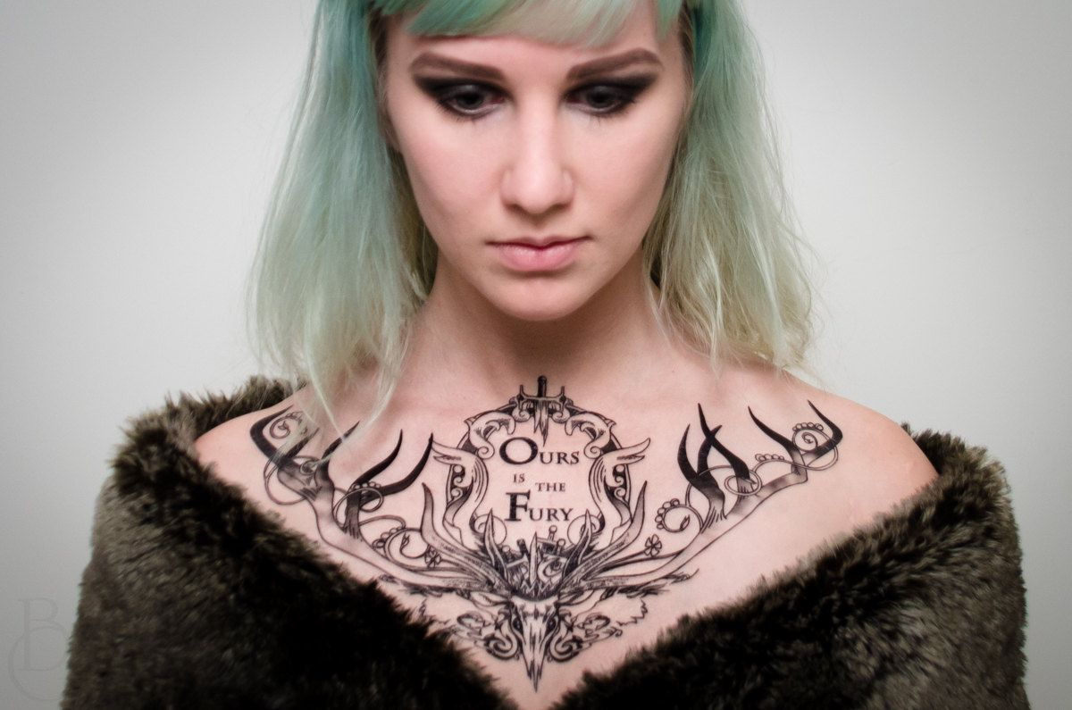 Fancy house of baratheon chest tattoo proper ink for Chest tattoos for females