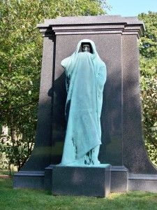 The monument of Dexter Graves, Graceland Cemetery, Chicago -Created by Lorado Taft in 1909, this sculpture was at one point entirely black. Chicago smog seems to have taken care of that, but its face is still dark. Legend has it that if you look into the statues face, you'll see your own death.