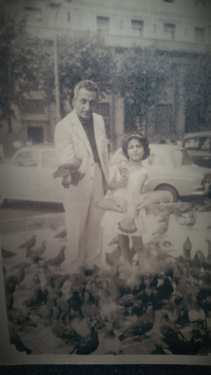My mom and Grandpa feeding pigeons Buenos Aires 1959