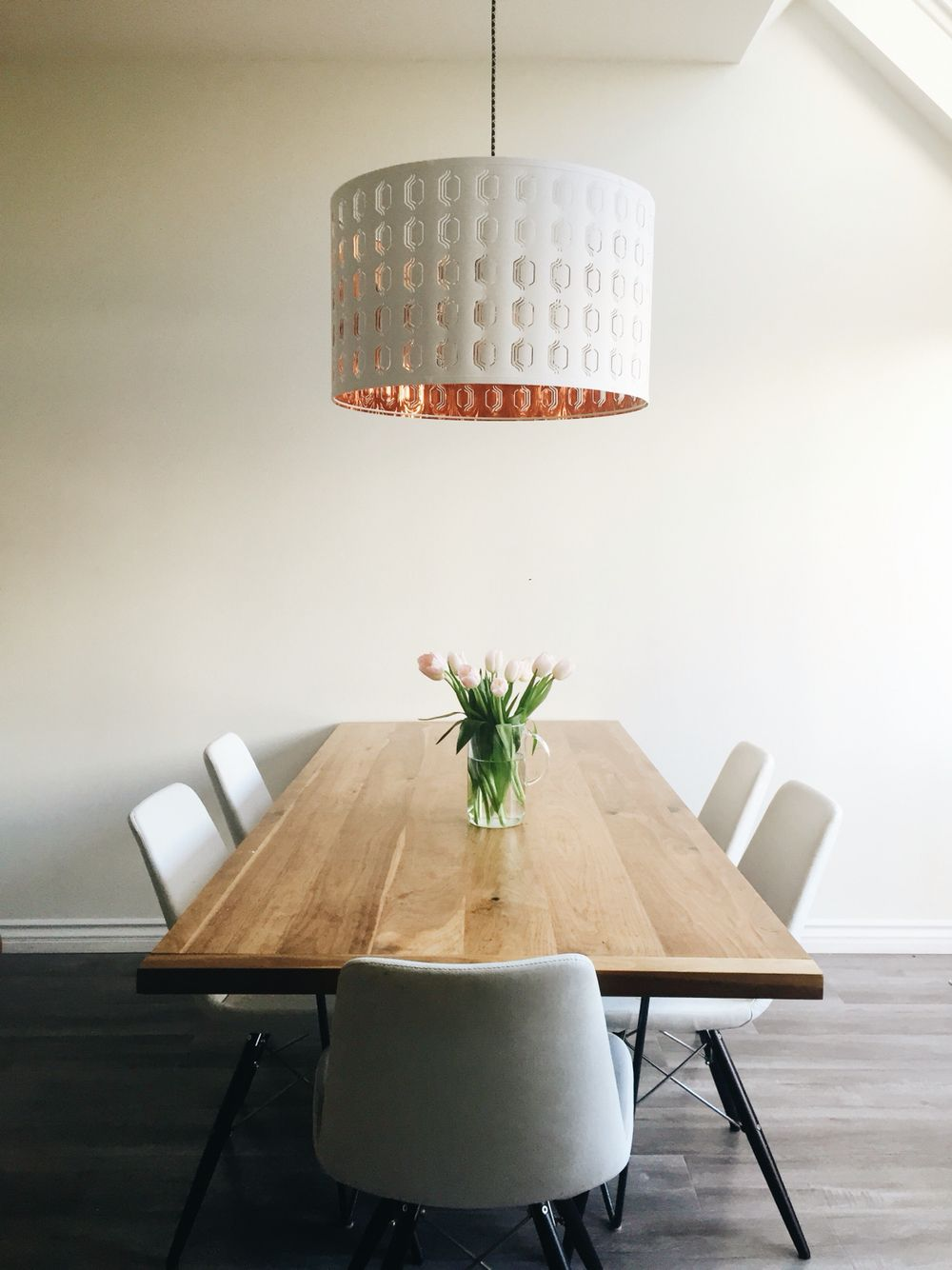 Minimalist Dining Room With Ikea Pendant Light In Copper And White