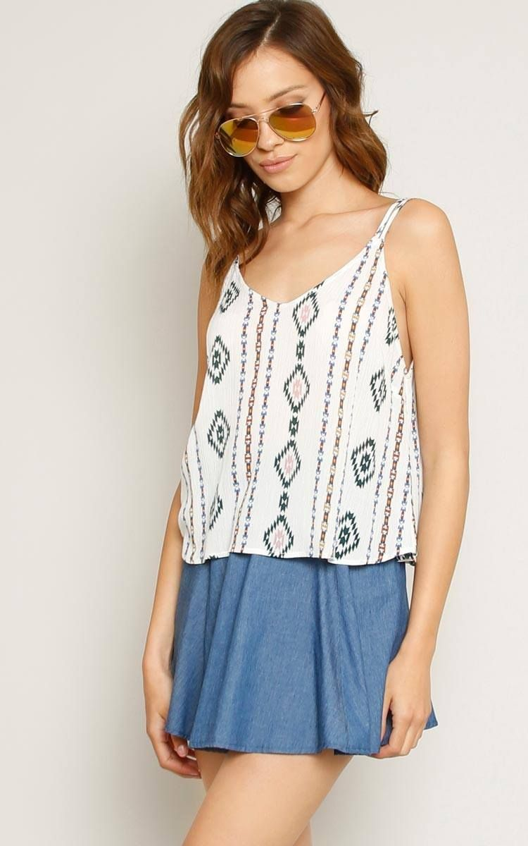 94b42d12507b5a Sleeveless woven top featuring a v-neckline. Two-toned Aztec boho print  throughout. Double straps. Unlined. Woven. Lightweight.100% RayonHand Wash  ...