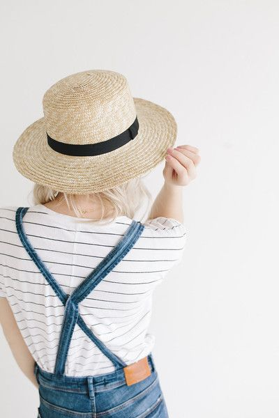 This natural brim boater has incredible personality and one size fits most women. The classic shape with traditional black band will have you singing no matter what the weather is.