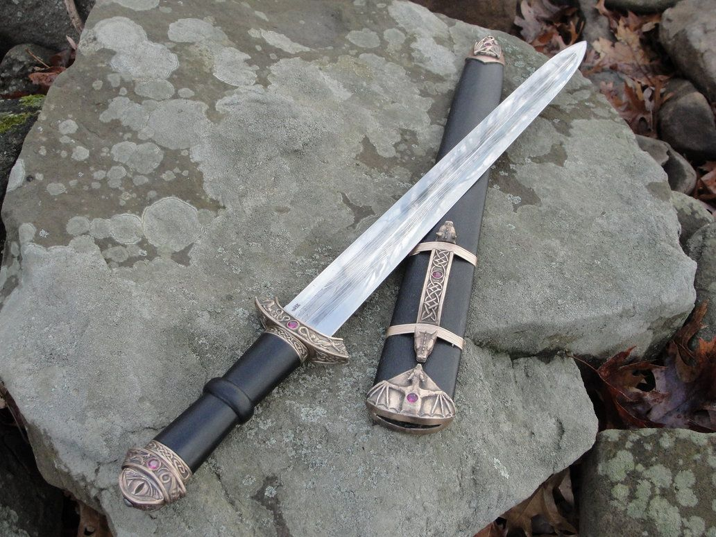 A very large pattern welded dagger/shortsword in a fantasy viking style.  Blade is a 2 bar pattern welded core of 1095 & 15N20, with a 1084 wrapped edge welded on.  The fittings are a...