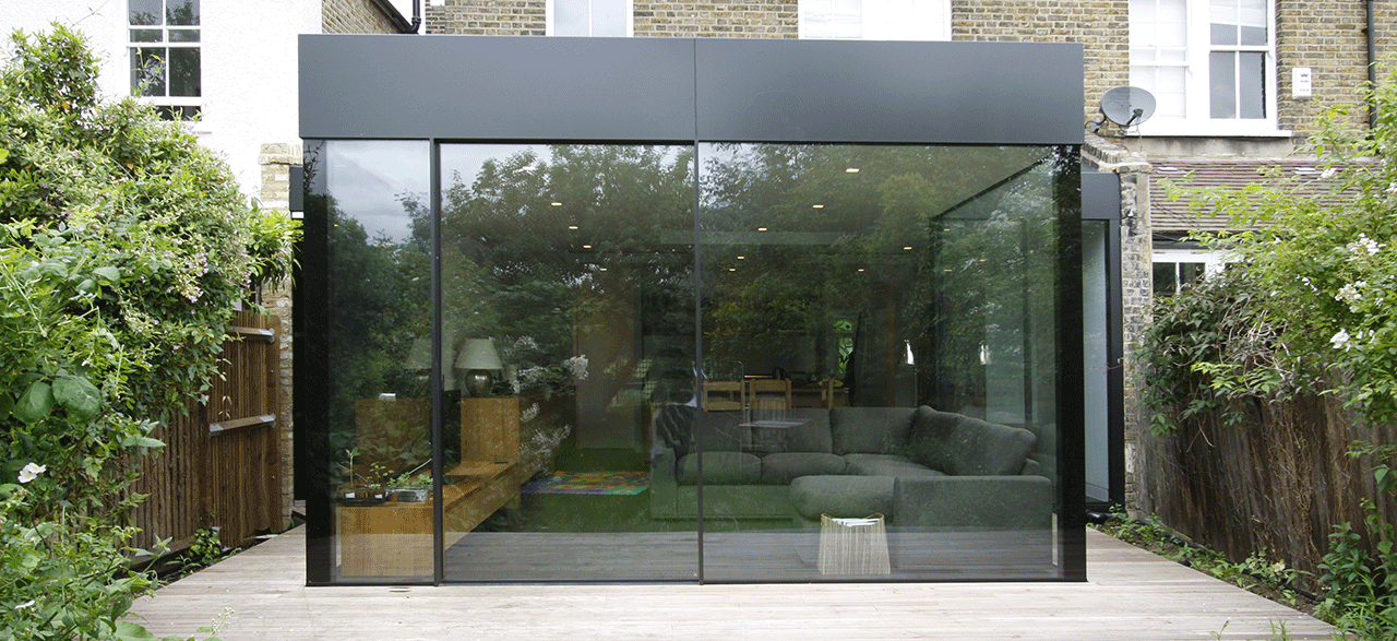Minimally framed sliding doors to the rear elevation of for Sliding glass doors extension