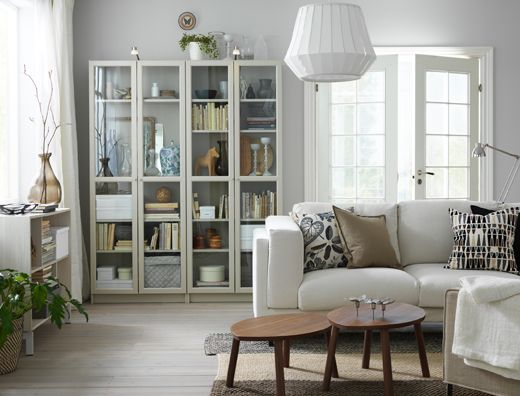 A Small Living Room Furnished With Light Beige Two Seat Sofa And