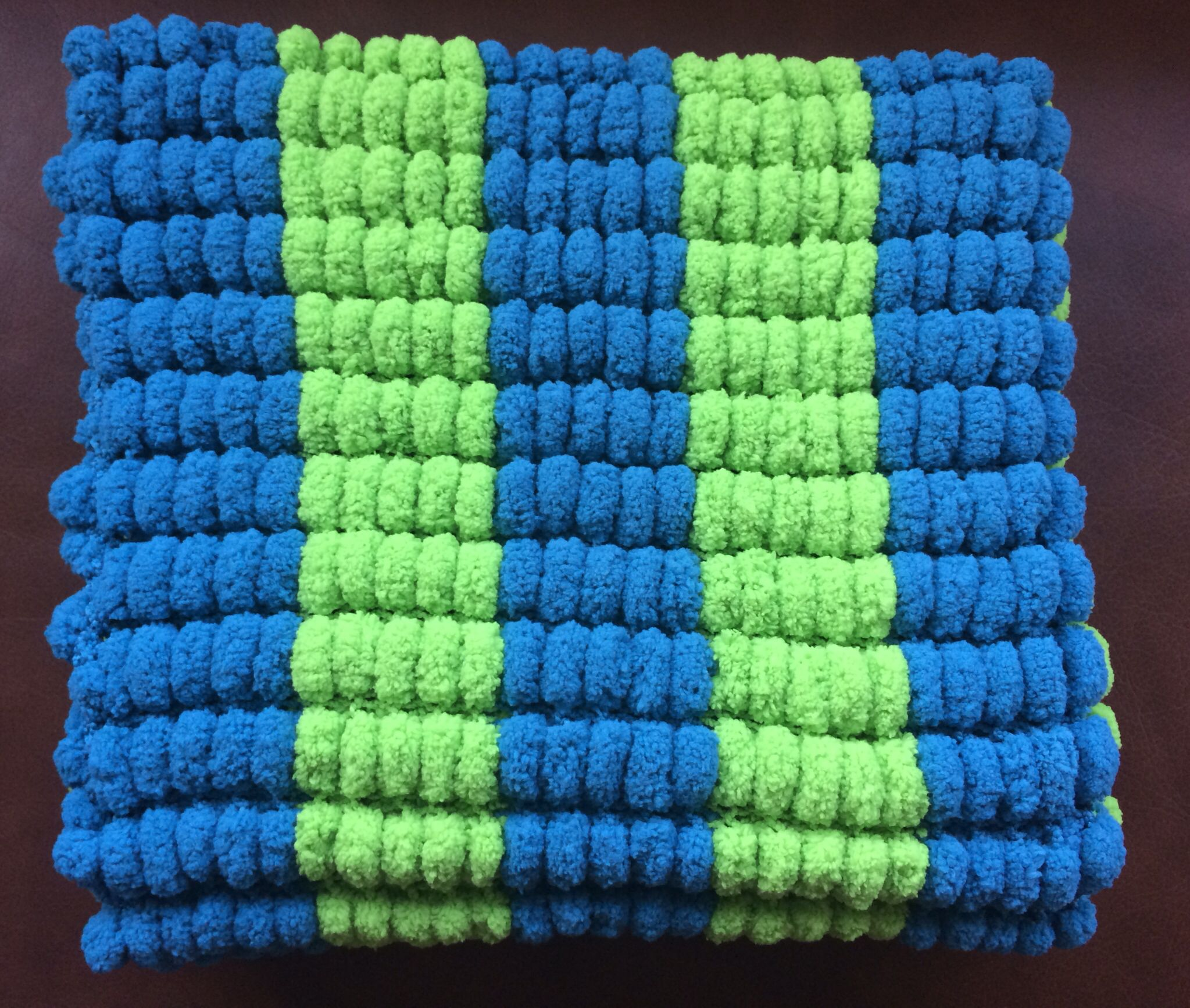 Lime and teal marshmallow blanket.  https://www.etsy.com/uk/listing/197424293/hand-knitted-marshmallow-pom-pom-baby?