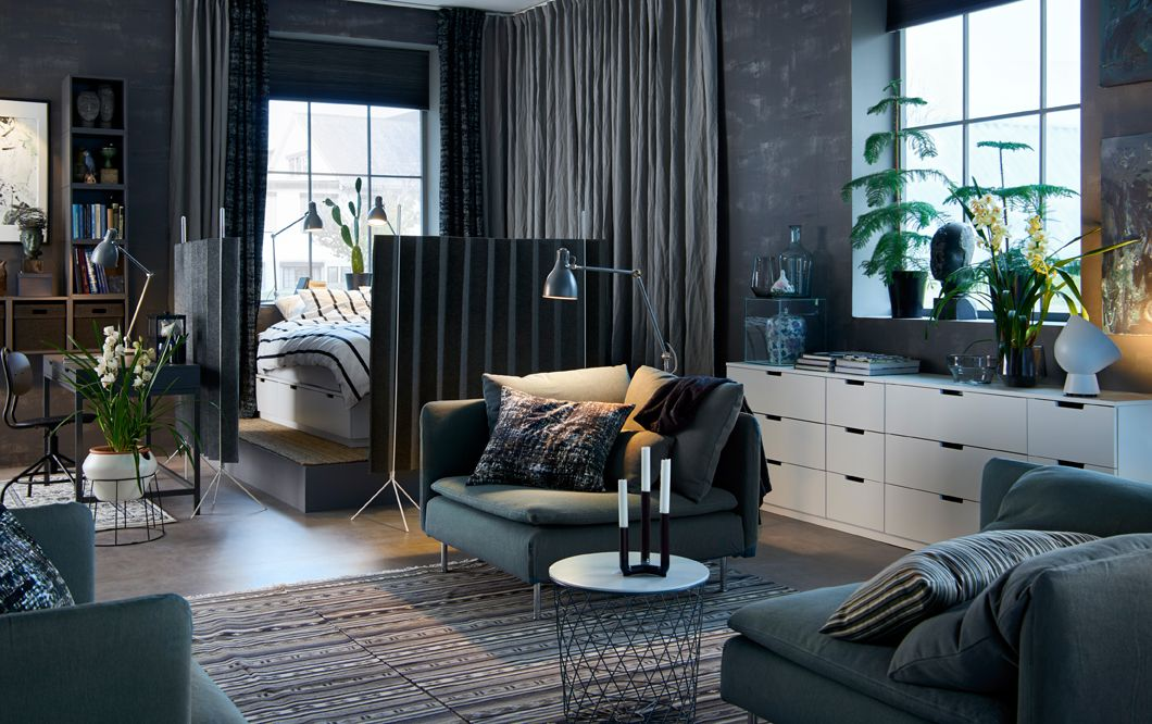 Dark Gray Open Plan Studio With A Bed In The Corner Surrounded By Room  Dividers.
