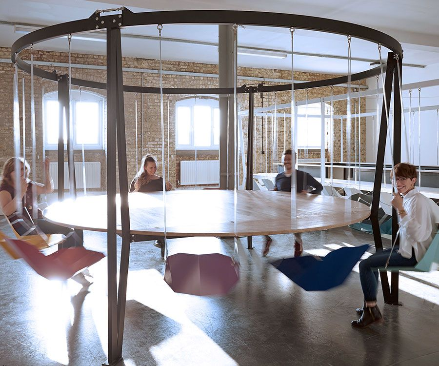 Swinging Chairs Round Table