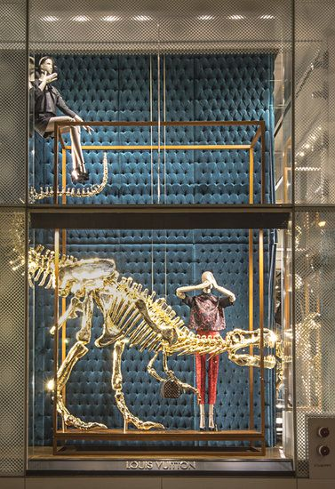 Louis Vuitton Window Display, Summer 2103. A mannequin covers its eyes next to a dinosaur skeleton / Photo courtesy of Louis Vuitton